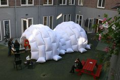 lambert kamps pillow tent. Very cool igloo sort of structure. connected fabric bags with air bags inside. I wonder about making modular units of these for people to add temporary insulation to their homes in the winter?