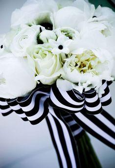 black & white striped ribbon wedding bouquet / http://www.himisspuff.com/black-and-white-sassy-stripes-wedding-ideas/2/