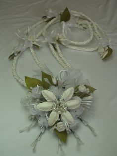 White Wedding Lasso Traditional handmade lasso cord with handmade vintage flowers ~ www.vowsandkisses.com ~ Wedding officiants creating customized, memorable ceremonies for all couples.