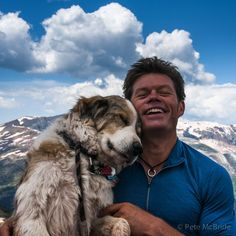"""Pete McBride on Instagram: """"High mountain Huckleberry Hug. After nine years chillin' by my side every minute when I was home, my favorite photo helping hound, Sir Huck (aka Huckybear, Huggleberry, Snuggleberry) moved on. This Buddha-like, Jedi Master was raised by a village but in reality, his loving, patient soul raised the spirits of all the villagers around him. #furryfriend #gutpunch #dog #canine #greatpyrennes #colorado #cancersucks"""""""