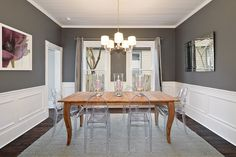 Benjamin Moore Kendall Charcoal paint color on the walls combined with white wainscoting in the formal dining room. Dining Room Paint, Dining Room Colors, Room Paint Colors, Paint Colors For Living Room, Dining Room Design, Dining Nook, Wall Colors, Floor Colors, Dining Tables