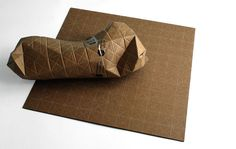 Sick of square boxes for your odd-shaped parcels?  Designer Patrick Sung came up with flat sheets of recyclable corrugated cardboard called the Universal Packaging System or UPACKS