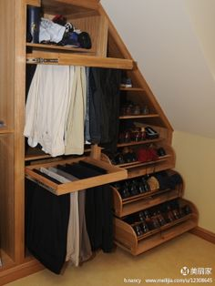 Tilt down shoe storage in stairs, plus pull-out pants racks to prevent…