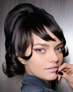 "Spring Makeup Idea: Violet Eyeliner  While full-on pink shadow can make your eyes look bloodshot, a violet-pink shade flatters. We loved the bold lid at Jeremy Scott, here; to re-create it, apply MAC Fluidline in Phlox Garden ($16, nordstrom.com) with a pointed brush and wing it out 1/2"" away from the eye."