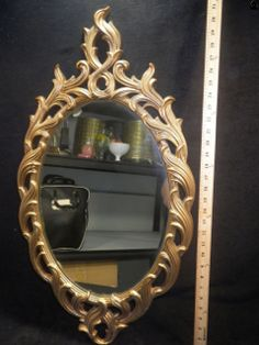 Oval Shaped Mirror in Gold Resin Frame