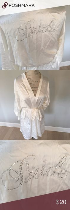 "Silk Victoria Secret Bride Robe Brand new, never worn Victoria Secret white silk robe with crystal ""Bride"" on the back on the robe.  Perfect condition. Non smoking home. Victoria's Secret Intimates & Sleepwear Robes"