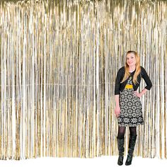 This is a pretty cool backdrop! Large Gold Fringe Curtain Decoration - OrientalTrading.com