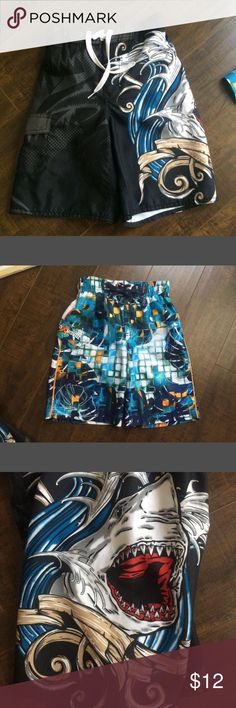Boys Swimtrunks Old Navy size small (6-7) with shark. In gently used condition. The 2nd picture is  size 5/6 from Kohls. In great condition. This pair has sun protection. Price is for both pair. My son wore both pair during the summer. They are very similar in size. Old Navy Swim Swim Trunks