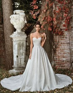 Justin Alexander signature wedding dresses style 9858 Beauty lies within the subtle details of this organza ball gown with allover lace appliques, a sweetheart neckline, natural waist, and monarch length train.