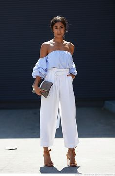 Love everything about this off the shoulders baby blue top paired with the high waisted white pants. #streetstyle