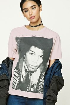 A knit graphic tee featuring a graphic of Jimi Hendrix, a crew neckline, short sleeves, and a raw-cut hem.