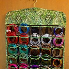 Great idea that popped into my head when I was trying to organize my bangles. A must for all Indian girls! Now I can hang them in the closet next to my salwars and saris =)   These hanging jewelry organizers are pretty easy to find and relatively inexpensive. Best thing: they're double sided so you can stick all your other dress jewelry in the pockets on the other side!