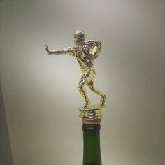 Flag Football Football Wine Stopper by TheDecorativeCompany