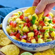 Fresh pineapple salsa is easy to prepare! A vibrant blend of sweet pineapple tomatoes jalapenos lime juice red onion and cilantro delivers big flavor. A great addition to top on grilled meat or served as a light appetizer with chips. Light Appetizers, Appetizer Recipes, Meat Appetizers, Clean Eating Snacks, Healthy Snacks, Healthy Recipes, Jalapeno Salsa, Fruit Salsa, Mango Pineapple Salsa