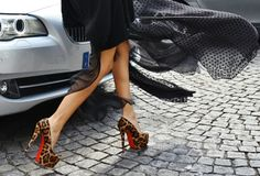 """Ton snapped the above photo of some very brave lady wearing a pair of towering Christian Louboutin Daffodile Pumps at the recent Paris Haute Couture Week""--oh to have the Parisian insociance to walk over cobblestones in needle thin heels"