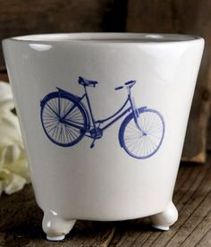 7.99 SALE PRICE! Get playful with your indoor plants with this Amsterdam-inspired Bike Pot. This white ceramic pot has a blue bicycle painted on the front an...