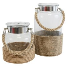 Set of 2 jar-inspired glass candle lanterns with woven rope details. Product: Small and large candle lanternCons. Sisal, Candle Lanterns, Glass Candle, Yankee Candle Jars, Sea Glass Colors, Lantern Set, Large Candles, Beach House Decor, Home Decor Bedroom