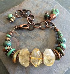 Chunky, faceted citrine nuggets sit between all sorts of natural green turquoise in this great chunky, rustic bracelet along with copper spacer beads, copper wavy discs and a chunky copper chain that allows it to be adjustable to 8 with a copper lobster claw clasp.