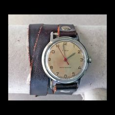 vintage timex watch on a brown leather wrap style band by handmadebychloed on Etsy