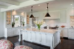 White kitchen - Cabinets by the sink/windows (love how they go all the way down to the base cabinets).