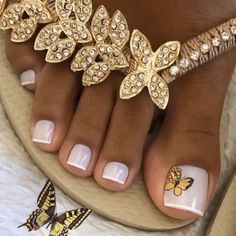 Toe Nail Designs: Yellow Butterfly. A butterfly design paired with a soft grey polish. Click through for 30 toe nail design ideas. #toenaildesigns #pedicureideas #nailpolishideas IG: @frenchpedicures Gel Toe Nails, Acrylic Toe Nails, Gel Toes, Feet Nails, Toe Nail Art, Nail Designs Toenails, Pretty Pedicures, Pretty Toe Nails, Cute Toe Nails
