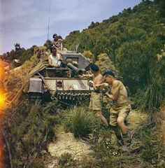 """THE BRITISH ARMY IN NORTH AFRICA, 1943: THE DRIVE ON TUNIS. Sergeant Elms of 16/5 Lancers and his tank crew at El Aroussa; Trooper Bates, R..."