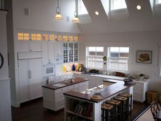 Love this kitchen, sink hidden from family room Loft Design, House Design, Glass Front Cabinets, White Cabinets, Marguerite Duras, Loft Interiors, Loft House, Living Styles, Indoor Outdoor Living
