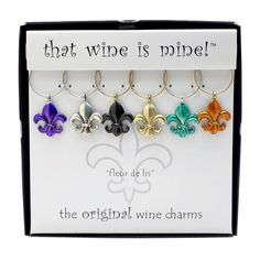 Wine Charms, Fleur De Lis  >>  Fleur de lis historically signifies French royalty, perfection, light and life and the flower of the lily. Adorn your wine glasses with this touch of the French.  6 charms in an elegant gift box Wide range of themes available