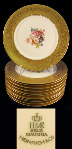 """Set of 12 German Porcelain Service Plates, 20th Century / The printed marks are """"Heinrich & Co., Bavaria, 20th Century"""". The centers are painted with naturalistic flowers /5000"""