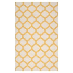 Anchor your living room seating group or define space in the den with this hand-woven wool rug, featuring a quatrefoil trellis motif for eye-catching appeal....