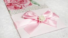Pink flower with pink ribbon as seal