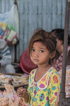 Cambodian girl in her PJs in Kratie Market, Cambodia