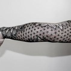 Other side of black and grey linework geometric mandala arm sleeve tattoo
