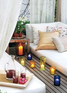love this porch/deck with curtains
