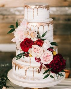 naked wedding cake topped with flowers,Gold drip semi naked wedding cake inspiration,wedding inspiration,