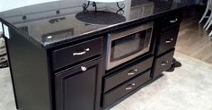 This made from 3 standalone cabinets from a home improvement store….cool way to make a cheap.island
