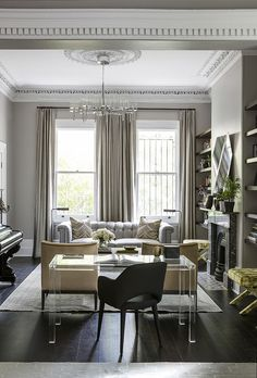 style profile: luxe modern living room space//  //modern living room space with luxurious floor to ceiling drapery and a barely there but statement making clear desk//