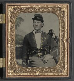 (c. 1861-1865) Soldier of the 26th New York Infantry Regiment with revolver in front of painted backdrop