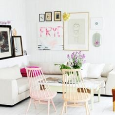 Stunning white lounge room with splashes of bright colour!