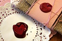 Seal your valentine with a home made wax seal.  The wax is melted crayon and the stamp cut from a potato!