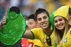 SAO PAULO, BRAZIL - JUNE 12: Brazil fans hold an image of the Incredible Hulk before the 2014 FIFA World Cup Brazil Group A match between Brazil and Croatia at Arena de Sao Paulo on June 12, 2014 in Sao Paulo, Brazil.  (Photo by Christopher Lee/Getty Images)