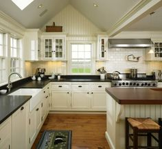 Sherwin Williams Creamy. Pretty paint colour choice for kitchen cabinets #Creamy