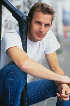 Kevin Costner Seated Holding Railing - January 01, 1990