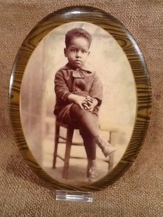 Serious young man with swag on a vintage photo button