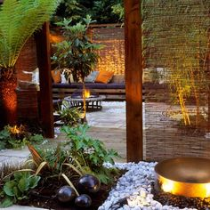 Exotic garden hideaway The perfect chill-out zone, this garden features a large seating area around a fire pit, making it ideal for entertaining. Year-round planting and subtle lighting add to the lush, cosy feel. Willow screens suspended from railway sleepers are staggered throughout the space to create 'rooms' that draw you through to the main seating area.