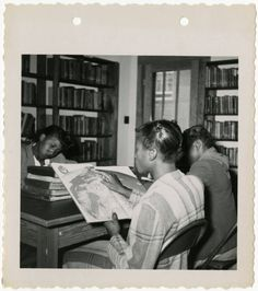 This image shows girls reading at the Orangeburg County Library. Back of the image reads 'Negro Service, Orangeburg County Library, 1950, Negro branch.' http://digital.tcl.sc.edu/cdm/ref/collection/scslchldrn/id/27