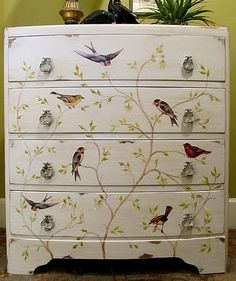 Gorgeous dresser. Tree is hand painted and birds are from decoupage.