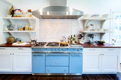 Julie White, Broadway Star's Cortlandt Manor, N.Y. Kitchen via NY Times. Love the blue Lacanche stove.