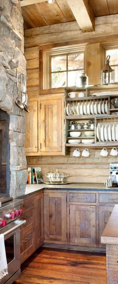 The rustic feel of the cabinets is perfect. I LOVE the pallet style open shelving. How can we do this!