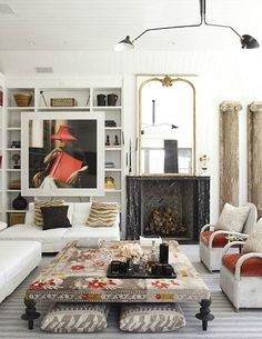 Saw this on both Desire to Inspire and If the Lamp Shade Fits, two of my fav blogs, and it is swoon-worthy! The ottoman could not be more perfect.